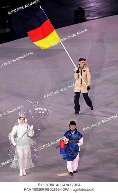Eric Frenzel, flag bearer of Germany, leads the athletes into the stadium during the opening ceremony of the 2018 Winter Olympics in Pyeongchang, South Korea