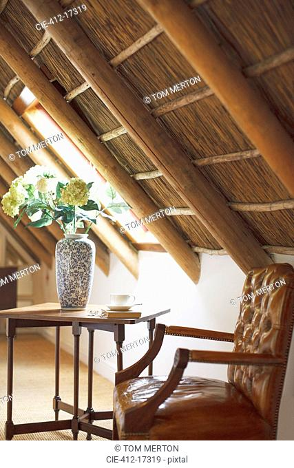 Bouquet in vase in luxury attic