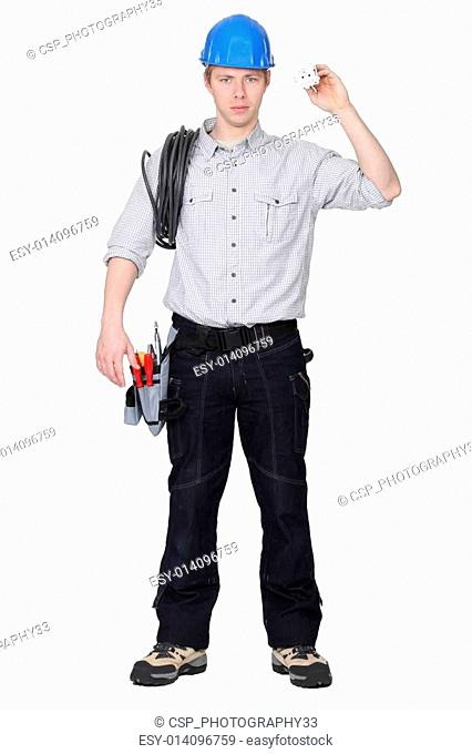 Electrician holding cable and electrical socket