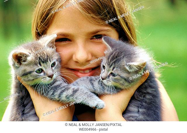 Twin kittens with young girl, 10 yrs. Old