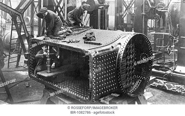 Steam locomotive construction, stud bolts being riveted, Borsigwerke, Berlin-Tegel, Germany, 1910