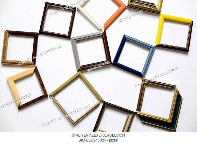 Picture frames on white table
