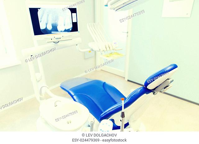 dentistry, medicine, medical equipment and stomatology concept - interior of new modern dental clinic office with chair