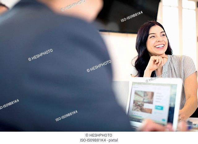 Over shoulder view of young businesswoman at office desk