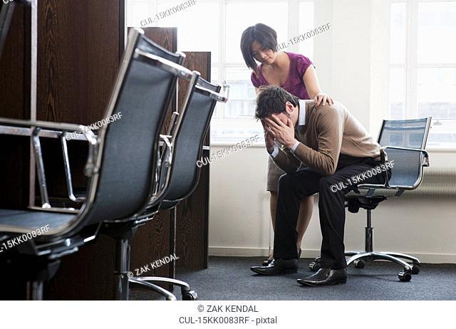 Women consoling a man