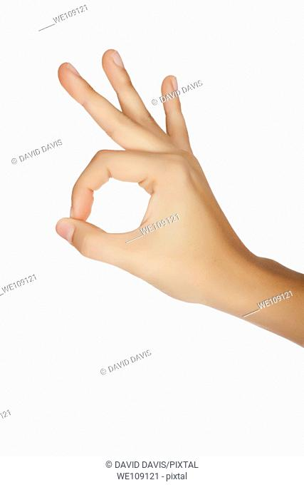 Caucasian female using hand gestures to say ok