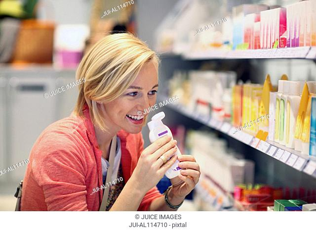 Woman shopping for cosmetics in organic grocery store