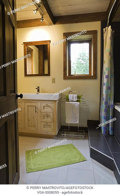 Main bathroom inside a cottage style log home, Quebec, Canada. This image is property released. CUPR0284
