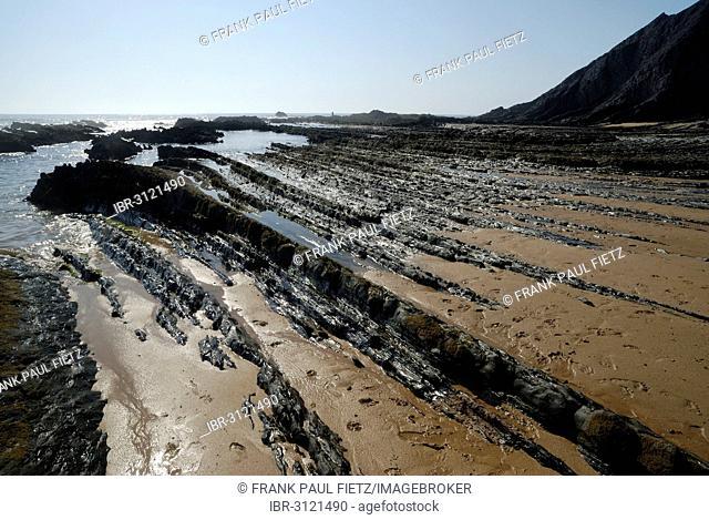 Rocks on the beach, on the Atlantic coast, Praia da Amoreira beach, Aljezur, Faro District, Portugal