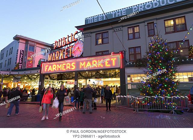Seattle, Washington: Shoppers and visitors crowd Pike Place Market as the Christmas holiday approaches