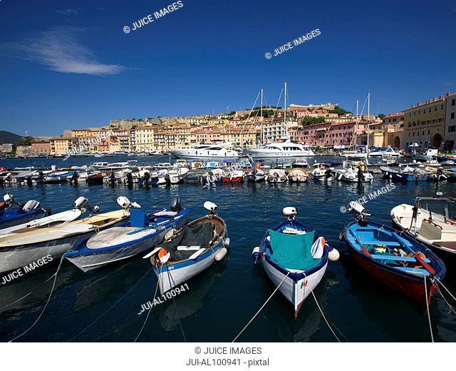 Harbor with boats and view to Forte Falcone, Portoferraio, Island of Elba, Province of Livorno, Tuscany, Italy
