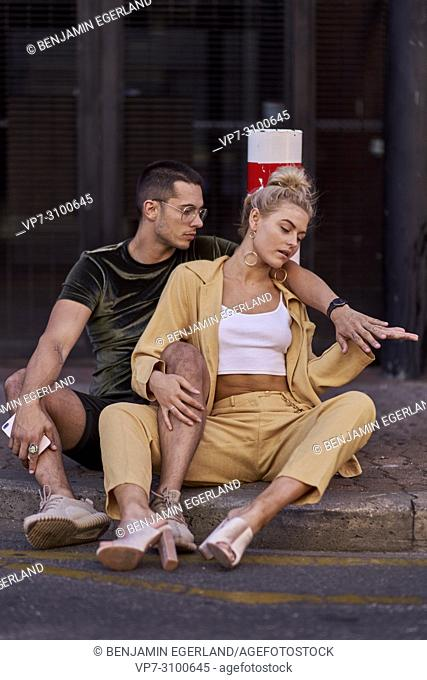 Australia, Adelaide, Fashion Bloggers Sarah Jeavons and Reno Marrasso sitting on street, couple, thoughtful, cool attitude, relationship, sensitive, feelings