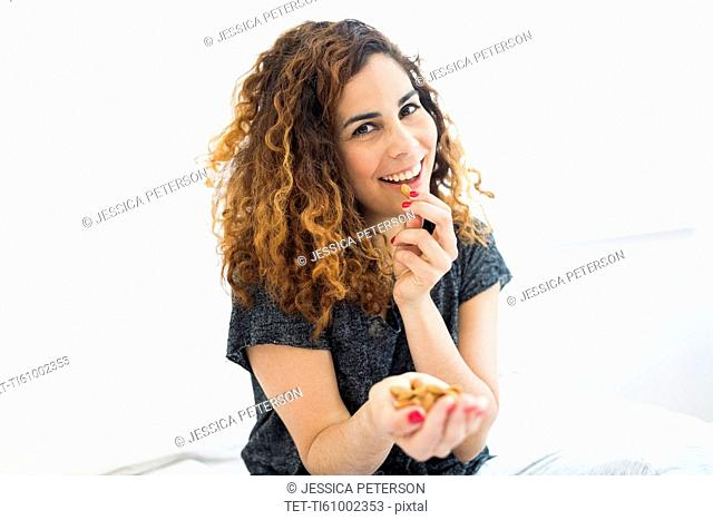 Woman eating almonds
