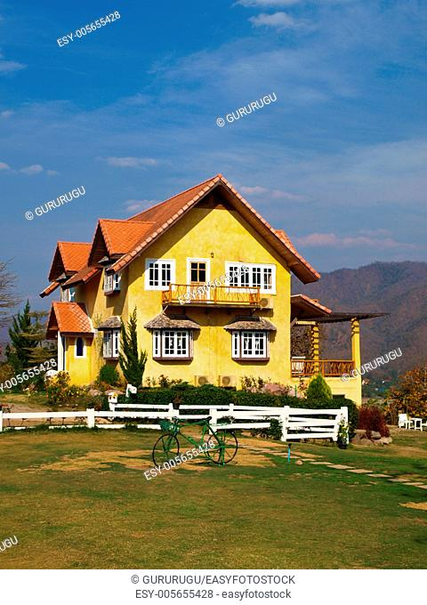 Yellow lovely house and blue sky in pai, mae hong son, thailand