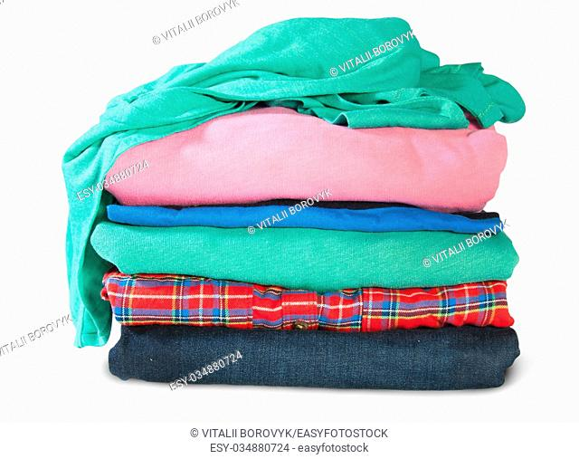 Stacked And Crumpled Clothes Isolated On White Background