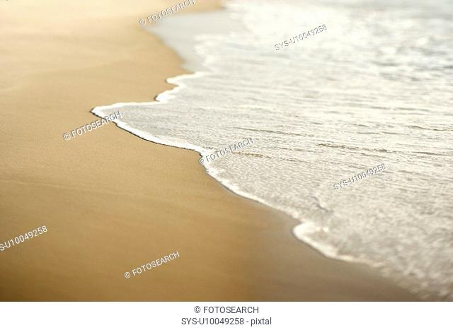 Image of sandy beach with waves