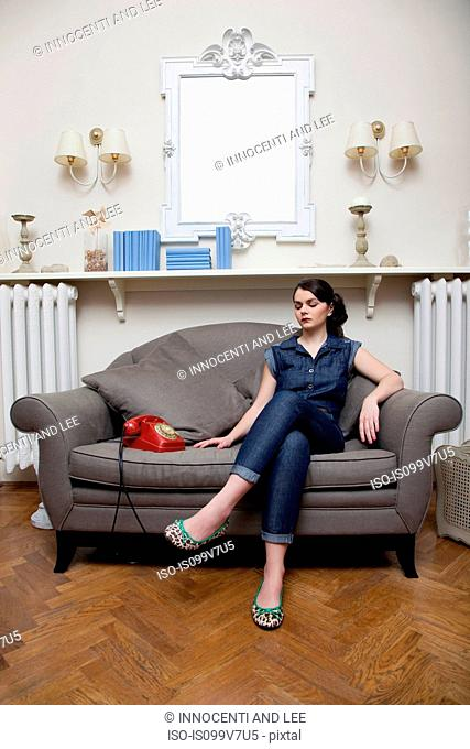 Woman on sofa with telephone