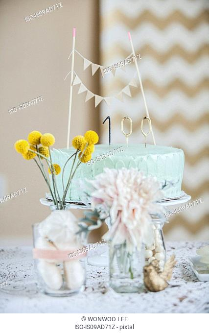 Still life of celebration cake with flowers and decoration