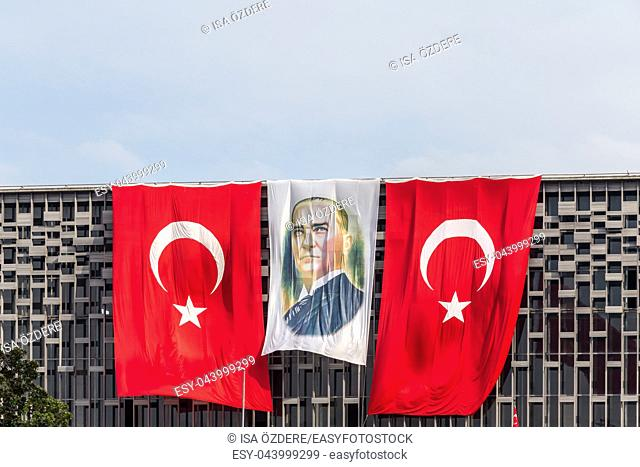 Picture of Ataturk stands between Turkish Flags above Ataturk Culture Center,Istanbul,Turkey. June 06 2014