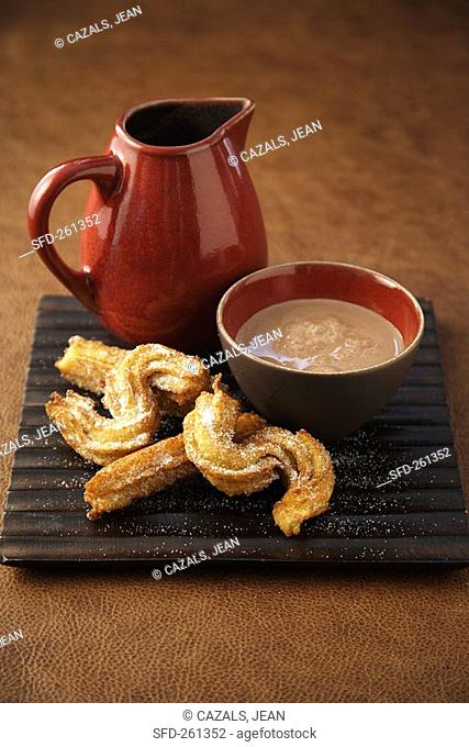 Churros deep-fried pastries with chocolate sauce