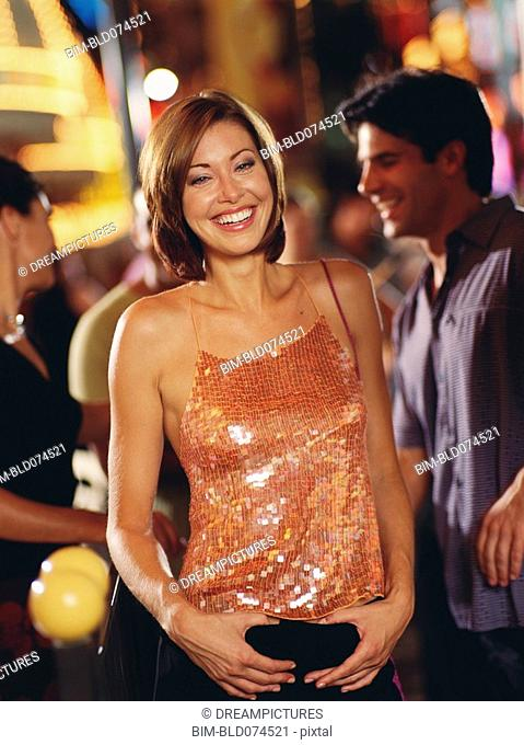 Woman smiling in nightclub