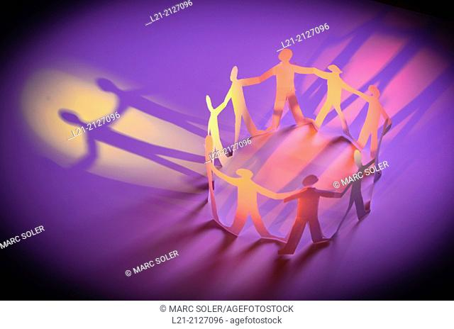 Paper chain people holding hands in a circle