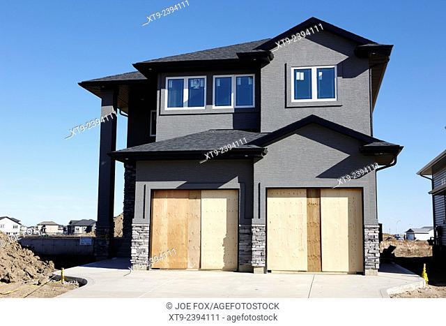 development of new suburban timber framed home saskatoon Saskatchewan Canada
