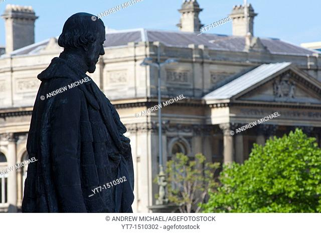 A statue of Disraeli, Earl of Beaconsfield at George's hall, looks towards the Walker Art Gallery, Liverpool, England