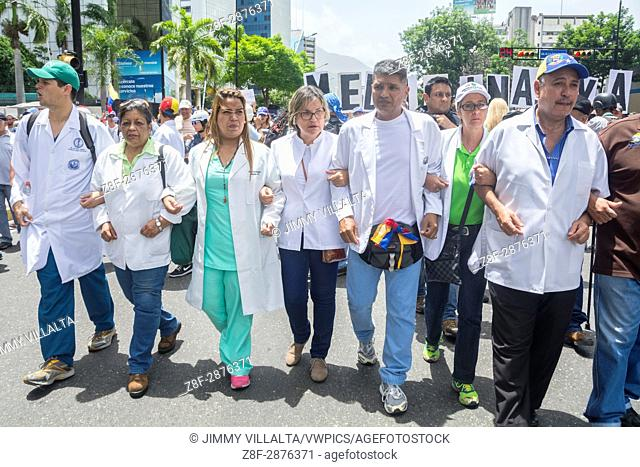 """Doctors, health personnel and nurses march on drug applications and a humanitarian channel for Venezuela. The opposition mobilization called """"""""Great March for..."""
