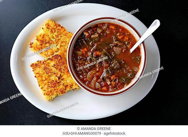 Bowl of Vegetarian Soup and Cornbread, High Angle View