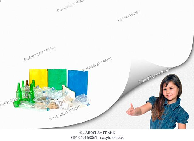 Cute little girl is showing a pile of sorted waste with ready colored bags on the white background ready for your text. All potential trademarks are removed