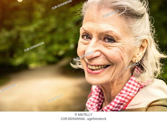Close up portrait of happy senior woman with grey hair