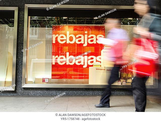 Sales sign in Spanish Rebajas and Basque beherapenak in Corte Ingles store window in Bilbao, Basque country, Spain, Europe