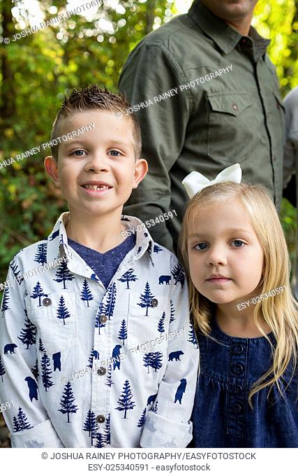 Two siblings in a portrait with closeup framing
