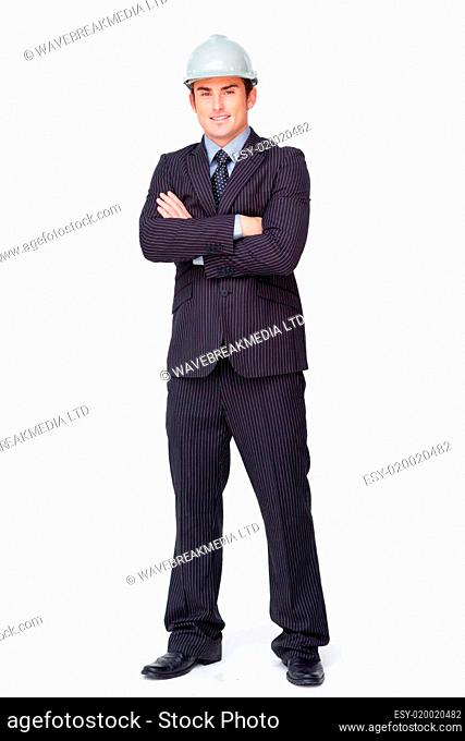 Standing attractive businessman with folded arms