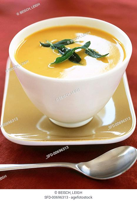 Bowl of Butternut Squash Soup with Sage Leaf Garnish