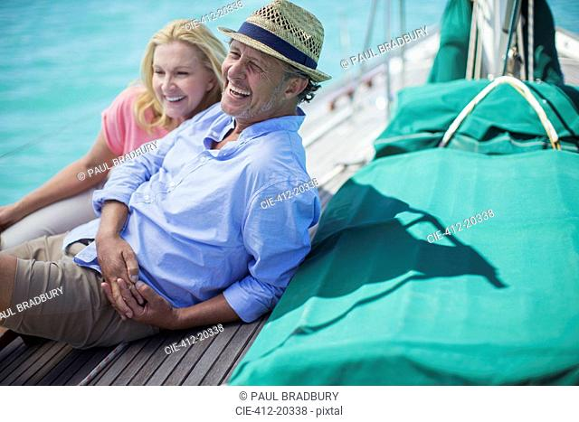 Couple sitting on boat together