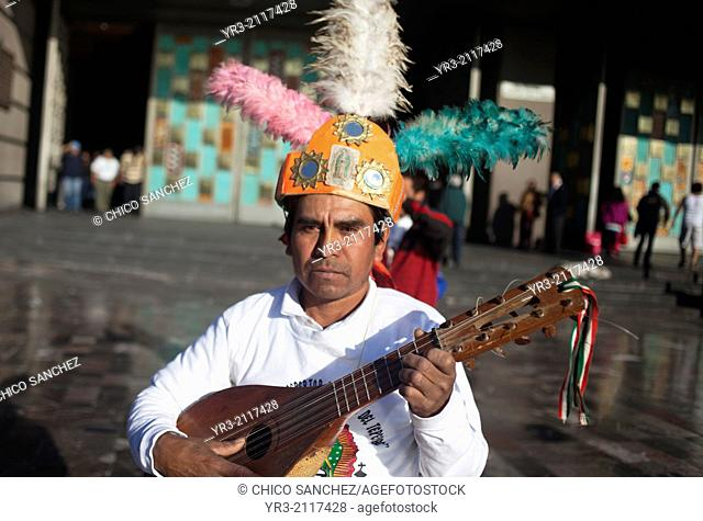 A conchero from Santiago Centro, Tamzle, San Luis Potosí, performs at the pilgrimage to Our Lady of Guadalupe Basilica in Mexico City, Mexico, December 10, 2013