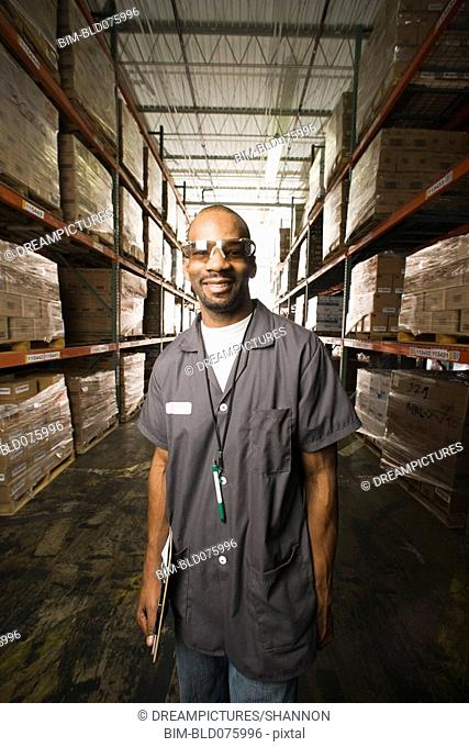 African man smiling in warehouse