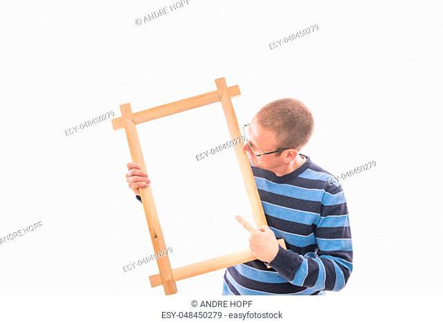 Man holds frame