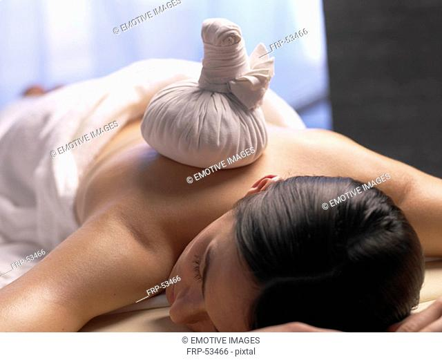 Woman get a massage with a compress