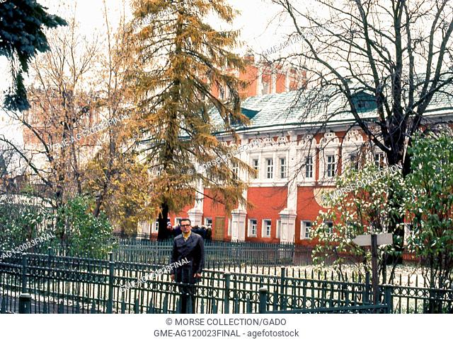 View of a Western man posing in a church courtyard within the Novodevichy Convent complex, in Moscow, Russia, Soviet Union, USSR, November, 1973. ()