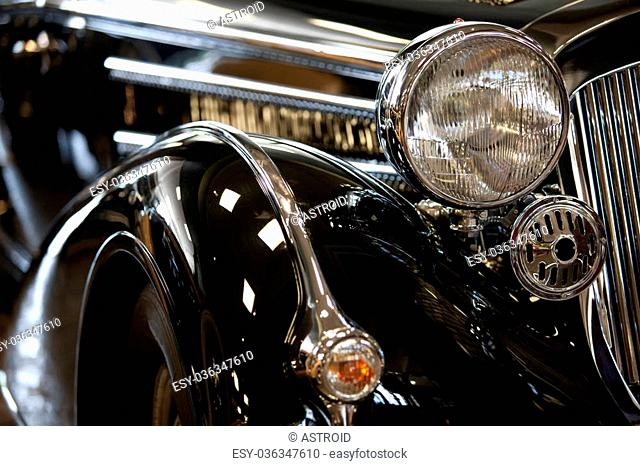 part of a black old car with headlamp