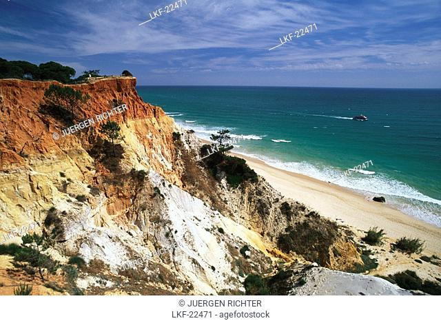 Praia da Falesia, rocky coast and beach under clouded sky, Algarve, Portugal, Europe