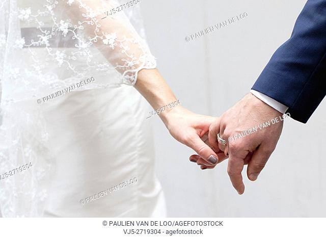 Helmond, Netherlands, a couple that is getting married is holding hands. They trust eachother