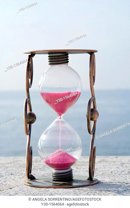 Hourglass with sea in background