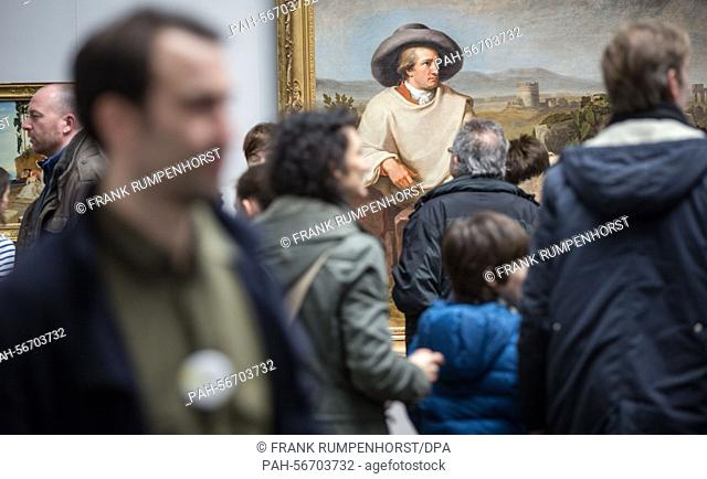 Visitors stand in front of the painting 'Goethe in the Roman Campagna' by Johann Heinrich Wilhelm Tischbein during the anniversary celebrations in Frankfurt a