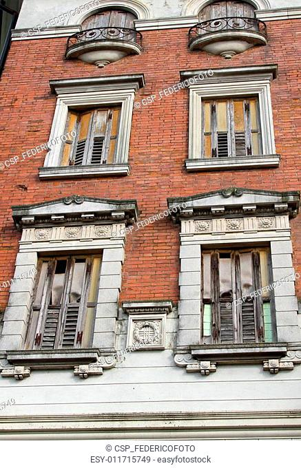 old building with balconies and wooden fixtures completely ruine