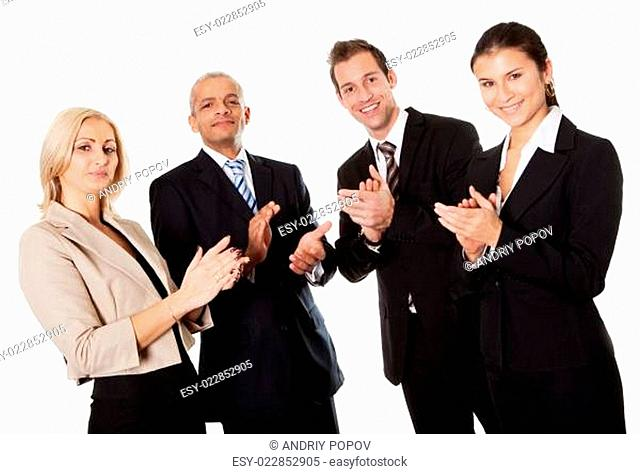 Four business people applauding