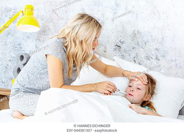 Bedroom - Sick child in bed - mother worries about her child
